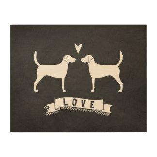 El perro del corredor de cross siluetea amor impresión en madera