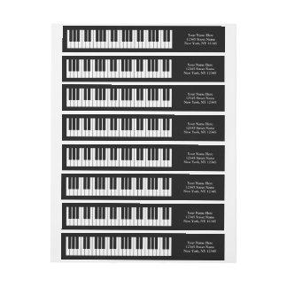 El piano de cola cierra etiquetas envueltas del etiquetas postales