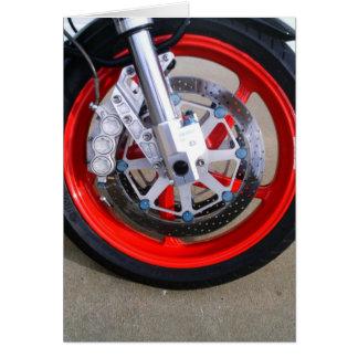El rojo de la rueda de la motocicleta de las tarjeta