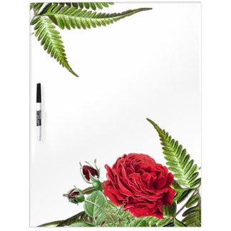 El rosa rojo botánico florece al tablero seco del