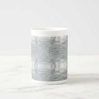 El sacar el polvo encima de una taza de la