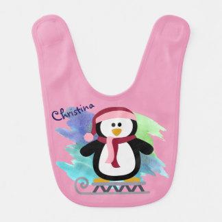El Sledding rosado del pingüino Baberos