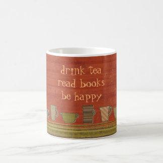 El té de la bebida leyó la taza roja oxidada feliz