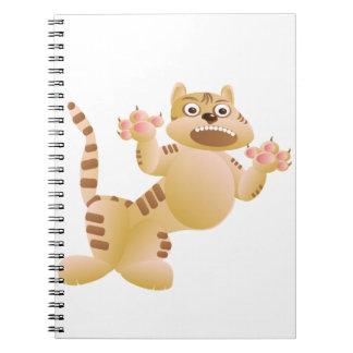 El tigre, el gato gruñe y amenaza a garras de las cuaderno