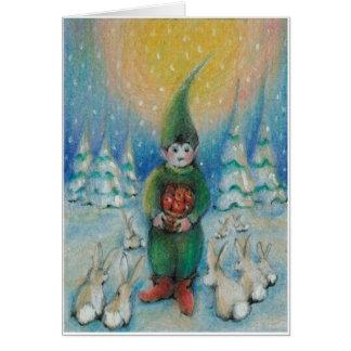 El tomte del muchacho alimenta conejitos de la tarjeta de felicitación