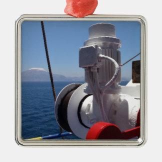 El torno y la costa africana de la nave adorno cuadrado plateado