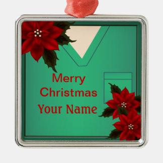 El verde de la enfermera friega el ornamento adorno navideño cuadrado de metal