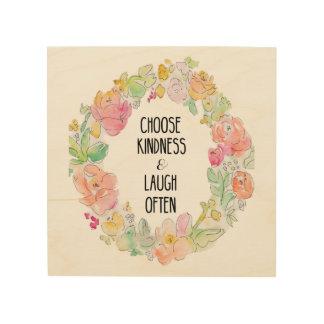 Elija la amabilidad y ría a menudo las flores de impresión en madera