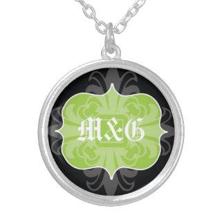 Emblema gótico del negro del verde de las colgante redondo
