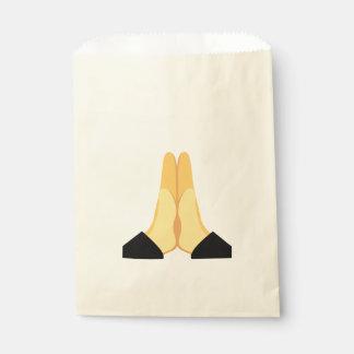Emoji de rogación bolsa de papel