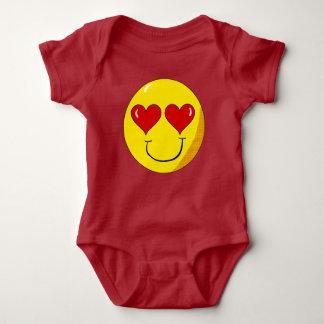 En camisa sonriente del bebé del amor