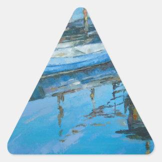 En el muelle pegatina triangular