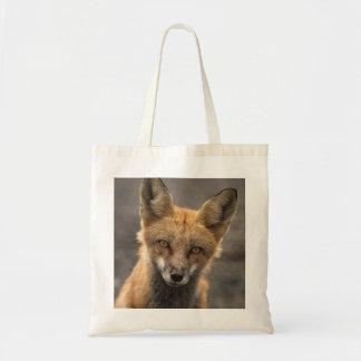 En sus ojos - la bolsa de asas del Fox rojo