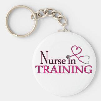 Enfermera en el entrenamiento - rosa llavero redondo tipo chapa