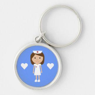 Enfermera y corazones lindos del dibujo animado llavero redondo plateado