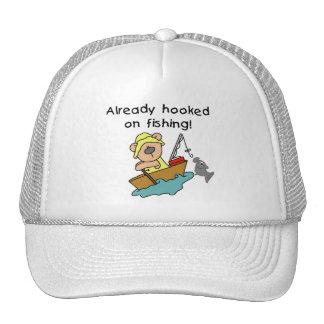Enganchado ya en las camisetas y los regalos de la gorras