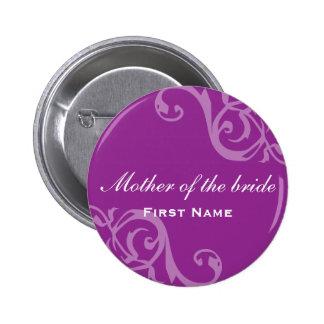 Enrolle el botón púrpura del perno de la insignia