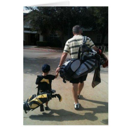 Equipo del golf del padre y del hijo tarjeton