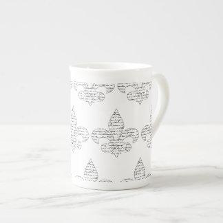 Escritura del francés de la flor de lis taza de porcelana