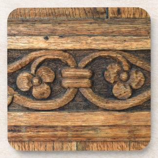 escultura de madera del panel posavasos