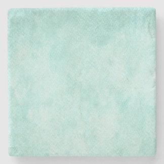 Espacio en blanco verde azul claro del fondo del posavasos de piedra
