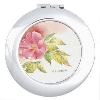 Espejo compacto color de rosa salvaje.