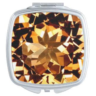 Espejo compacto del Topaz