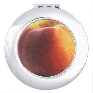 Espejo compacto redondo del melocotón