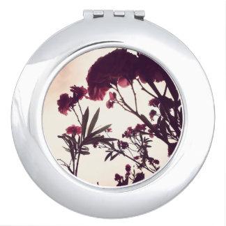 Espejo Compacto Rosa y tempestuoso por la naturaleza