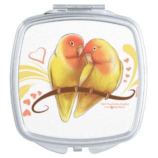 Espejo De Viaje El melocotón hizo frente a los Lovebirds de Lutino