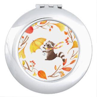 Espejos Para El Bolso Pequeño mapache lindo con el paraguas en guirnalda