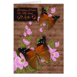 Esposa, con la mariposa de la aleta en el flor felicitaciones