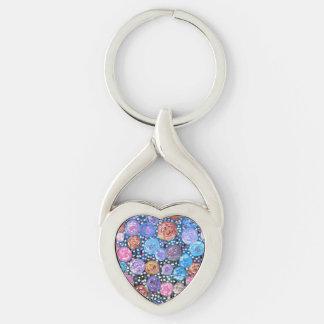 Estallido de la flor llavero plateado en forma de corazón