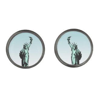 Estatua de las mancuernas de los inmigrantes de la gemelos metalizados