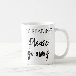 Estoy leyendo - va por favor la taza de café