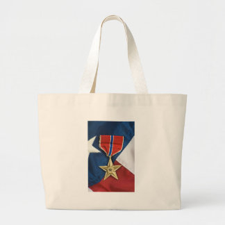 Estrella de bronce en bandera americana bolsas de mano