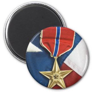 Estrella de bronce en bandera americana iman de nevera