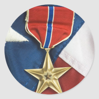 Estrella de bronce en bandera americana pegatina redonda