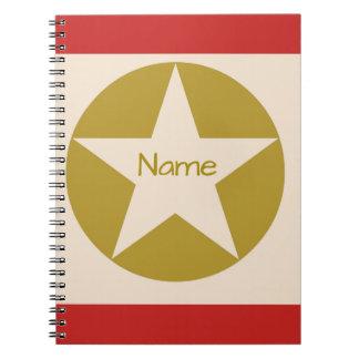 Estrella roja del moreno y del oro en un nombre cuaderno