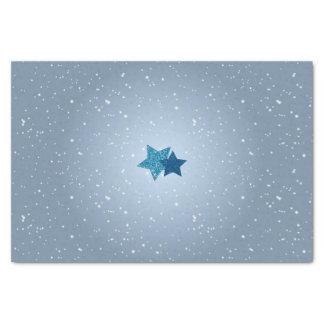 Estrellas azules de plata en tejido azul del papel de seda