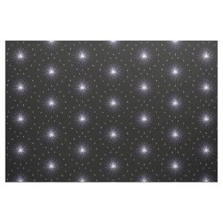 Estrellas azules en tela negra telas