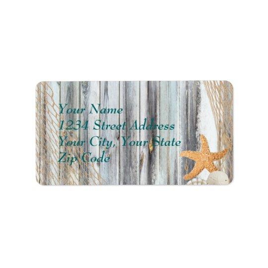 Estrellas de mar rústicas de la playa que casan la etiqueta de dirección