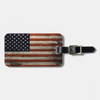 Etiqueta del equipaje con la impresión de madera