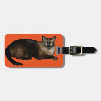 Etiqueta del equipaje del gato siamés con la