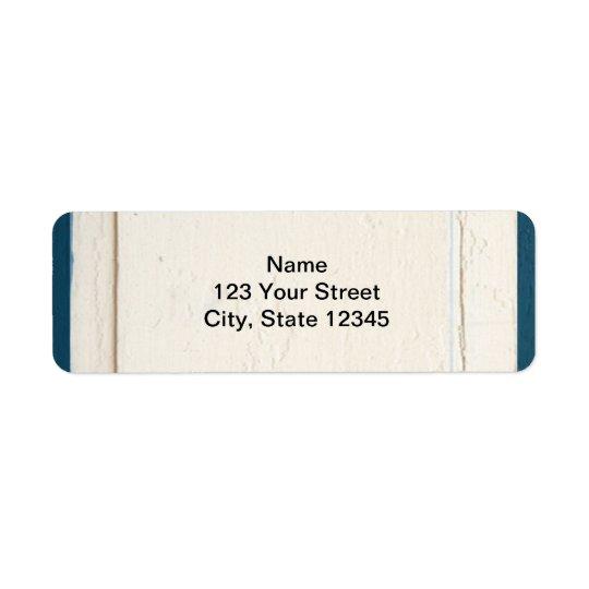 Etiqueta El panel de madera azul y poner crema
