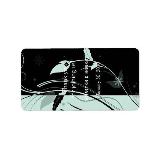Etiqueta floral azul y negra del protector labial etiqueta de dirección
