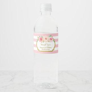 Etiqueta floral de la botella de agua del oro de