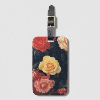 Etiqueta floral del equipaje