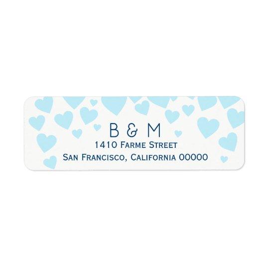 Etiqueta iniciales con casarse azul de los corazones del