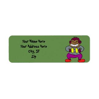 Etiqueta Mono retro con el juguete de los platillos